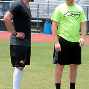Connor Barth Talks to Ben Utter, 17, Sunday July 13, 2014 during a kicking clinic at Hoggard High School in Wilmington, N.C. (Jason A. Frizzelle)