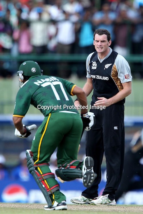 Kyle Mills reacts after some poor fielding during the ICC World Twenty20 Pool match between Pakistan and New Zealand held at the  Pallekele Stadium in Kandy, Sri Lanka on the 23rd September 2012<br /> <br /> Photo by Ron Gaunt/SPORTZPICS/PHOTOSPORT
