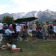 A race goer sleeps during competition at the 50th Anniversary Glenorchy Race meeting. The races, which originally started in the 1920's, were resurrected in 1962 and have been run by local farmers and the rugby club on the first Saturday after New Years Day ever since. Glenorchy, Otago, New Zealand. 7th January 2012