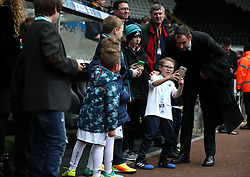 Swansea City manager Paul Clement poses with fans prior to the Premier League match at the Liberty Stadium, Swansea.