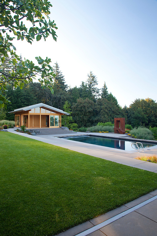 """Views of the swimming pool and the yoga pavilion which was designed by architect Michael McCulloch and Lee Kelly's sculpture entitled, """"Window to the Gone World."""""""