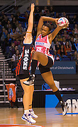 Carla Borrego with the ball for the Thunderbirds with Jessica Moulds for the Tactixin defence during the ANZ Championship Netball game between the Mainland Tactix v Adelaide Thunderbirds at Horncastle Arena in Christchurch. 20th April 2015 Photo: Joseph Johnson/www.photosport.co.nz