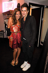 JADE JAGGER and DAN WILLIAMSat the opening of Jade Jagger's shop at 43 All Saints Road, London W11 on 25th November 2009.