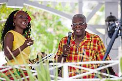 "Lisa Wynne Magnuson and Kenneth Blake recollect their favorite food to eat at the Cultural Fair.  ""Alvin's Cultural Workshop"" Cultural Fair honoring Mr. Alvin Turnbull.  Emancipation Garden.  St. Thomas, VI.  29 April 2015.  © Aisha-Zakiya Boyd"