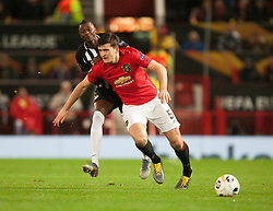 Harry Maguire of Manchester United (R) is fouled by Umar Sadiq of Partizan - Mandatory by-line: Jack Phillips/JMP - 07/11/2019 - FOOTBALL - Old Trafford - Manchester, England - Manchester United v Partizan - UEFA Europa League
