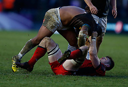 Edinburgh Rugby's Magnus Bradbury involved in an off the ball incident by Harlequins' Kyle Sinckler during the European Challenge Cup, pool five match at Twickenham Stoop, London.