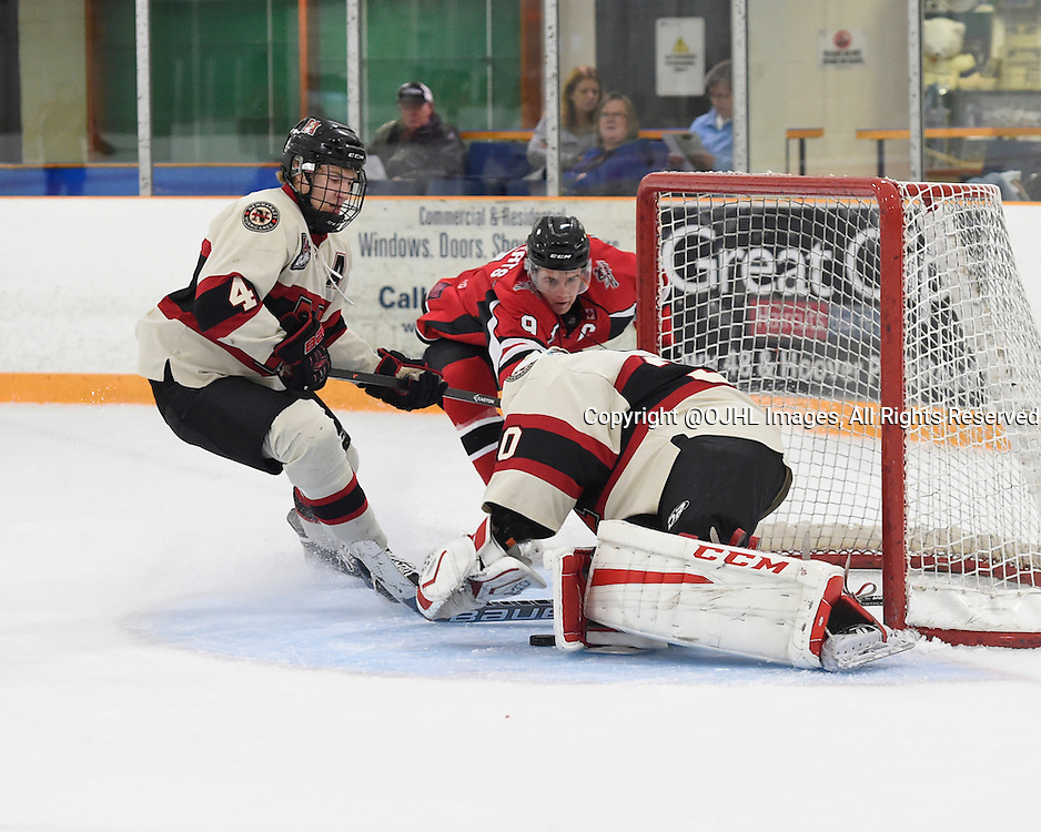 STOUFFVILLE, ON - Oct 12, 2015 : Ontario Junior Hockey League game action between Newmarket and Stouffville, Adam Smith #4 and Dalton Ewing #30 of the Newmarket Hurricanes keep the puck from Spencer Roberts #9 of the Stouffville Spirit during the first period.<br /> (Photo by Andy Corneau / OJHL Images)