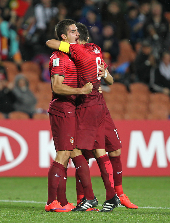 Andre Silva of Portugal (left) celebrates a goal with team mate Tomas in the group c game of the FIFA u20 World Cup at Waikato Stadium, Hamilton, New Zealand, Sunday, May 31, 2015. Credit:SNPA / Ben Campbell