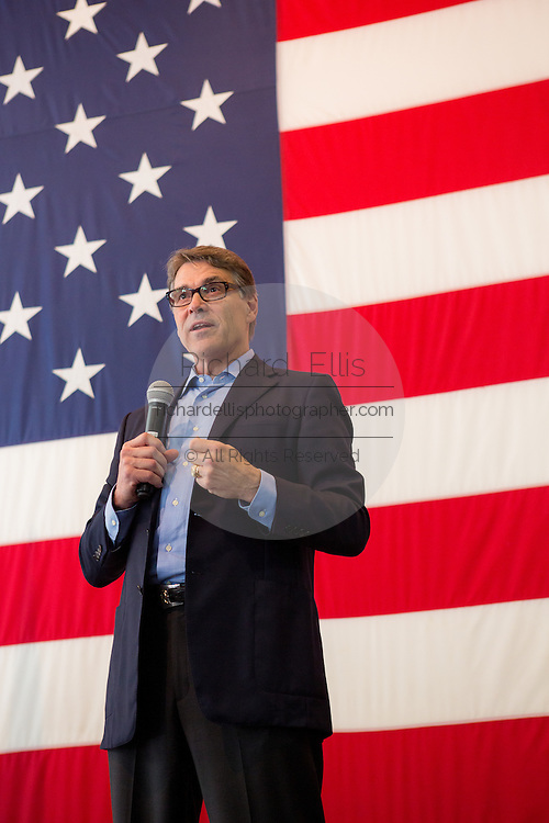 Former Texas Governor and GOP presidential hopeful Rick Perry addresses a crowd of supporters during a town hall campaign event aboard the USS Yorktown June 8, 2015 in Mount Pleasant, South Carolina.