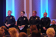 Officers stand to be recognized for their exceptional efforts over the past year.