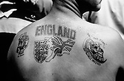 England Tattoo on lout's upper back, Italy, 1990.