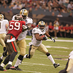 2008 September 7: New Orleans Saints running back Reggie Bush (25) rushes around the corner against the Tampa Bay Buccaneers at the Louisiana Superdome in New Orleans, LA.  The New Orleans Saints defeated the Tampa Bay Buccaneers 24-20.