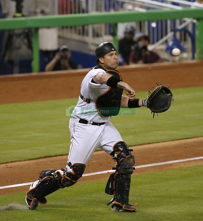 June 21, 2017 - Miami, FL, USA - Miami Marlins catcher A.J. Ellis throws to first to put out Washington Nationals shortstop Trea Turner during the sixth inning on Wednesday, June 21, 2017 at Marlins Park in Miami, Fla. (Credit Image: © David Santiago/TNS via ZUMA Wire)