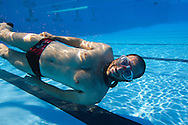 Freediving (or free-diving) is a form of underwater diving that does not involve the use of scuba gear or other external breathing devices, but rather relies on a diver's ability to hold his or her breath until resurfacing. Examples include breath-hold spear fishing, freedive photography, apnea competitions, and to some degree, snorkeling. The activity that garners the most public attention is the extreme sport of competitive apnea in which competitors attempt to attain great depths, times, or distances on a single breath.<br /> <br /> Dynamic Apnea covers two of the eight categories recognised by the International Association for the Development of Freediving. That of Dynamic Without Fins and Dynamic With Fins. Both disciplines require breath held dives where the diver travels in a horizontal position under water under their own power without aid/physical contact of a static surface, with the exception of the pool wall when done indoors. The records can only be recognized in pools of 25m or greater.<br /> <br /> The other categories recognized are: static Apnea, No Limit, Variable Weight, Free Immersion, Constant Weight, Constant Weight Without Fins,