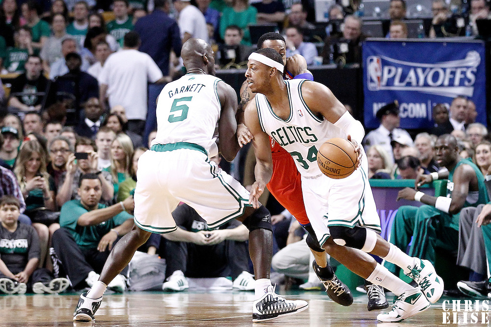 12 May 2012: Boston Celtics small forward Paul Pierce (34) drives past Philadelphia Sixers small forward Andre Iguodala (9) on a screen set by Boston Celtics power forward Kevin Garnett (5) during the Boston Celtics 92-91 victory over the Philadelphia Sixers, in Game 1 of the Eastern Conference semifinals playoff series, at the TD Banknorth Garden, Boston, Massachusetts, USA.