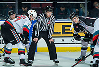 KELOWNA, BC - JANUARY 26: Linesman Dave McMahon stands at the face-off between Alex Swetlikoff #17 of the Kelowna Rockets and Eric Florchuk #14 of the Vancouver Giants at Prospera Place on January 26, 2020 in Kelowna, Canada. (Photo by Marissa Baecker/Shoot the Breeze)