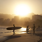 A late afternoon beach scene at Arpoador Beach with Ipanema and Leblon in the distance. Rio de Janeiro, Brazil. 8th August 2010. Photo Tim Clayton...