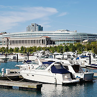 Photo of Chicago Soldier Field and Burnham Harbor luxury boats. Soldier Field is a popular Chicago sports stadium and is home to the Chicago Bears NFL professional football team. Photo is high resolution and was taken in 2010.