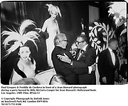 Paul Gregory & Freddie de Cordova in front of a Jean Howard photograph during a party hosted by Billy McCarty-Cooper for Jean Howard's Hollywood book. Los Angeles. 1989. Film.89322/13<br /><br />© Copyright Photograph by Dafydd Jones<br />66 Stockwell Park Rd. London SW9 0DA<br />Tel 0171 733 0108