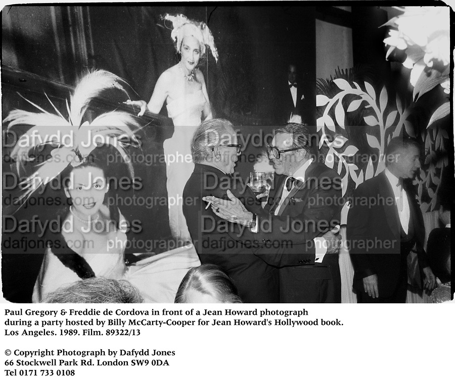 Paul Gregory & Freddie de Cordova in front of a Jean Howard photograph during a party hosted by Billy McCarty-Cooper for Jean Howard's Hollywood book. Los Angeles. 1989. Film.89322/13<br />