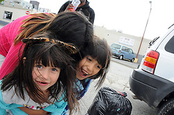 Playtime in the parking lot for Jenifer, 5, Marlen, 7, and Iris Garcia in pink. The girls are waiting for the warming shelter to open at 20 W. Market St. in Salinas.