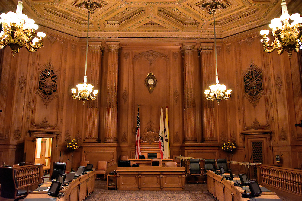 City Hall Supervisors&rsquo; Legislative Chamber in San Francisco, California<br /> The Board of Supervisor&rsquo;s Chamber in the San Francisco City Hall is where the eleven representatives of the city meet each Tuesday to conduct local government business. The room is surrounded by intricately carved Manchurian oak panels and the furniture is California oak. The ceiling also looks like wood but is actually plaster.