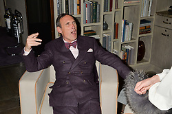 AA GILL at a reception to celebrate the publication of The Shadow of The Crescent Moon by Fatima Bhutto at the Belgraves Hotel, 20 Chesham Place, London, on 2nd December 2013.