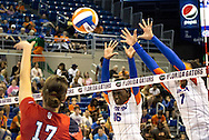 Florida's Simone Antwi (16) and Gabby Mallette attempt to block a spike from Pelin Aroguz. (photo by Samuel navarro)