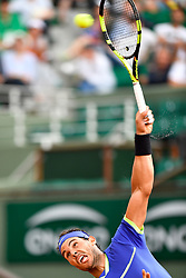 PARIS, June 2, 2017  Rafael Nadal of Spain serves the ball to Nikoloz Basilashvili of Georgia during the men's singles 3rd round match at the French Open Tennis Tournament 2017 in Paris, France on June 2, 2017. (Credit Image: © Chen Yichen/Xinhua via ZUMA Wire)