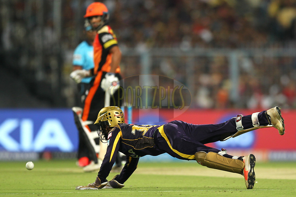 Dinesh Karthik of the Kolkata KnightRiders tries to take catch during match ten of the Vivo Indian Premier League 2018 (IPL 2018) between the Kolkata Knight Riders and the Sunrisers Hyderabad held at the Eden Gardens Cricket Stadium in Kolkata on the 14th April 2018.<br /> <br /> Photo by: Deepak Malik / IPL/ SPORTZPICS