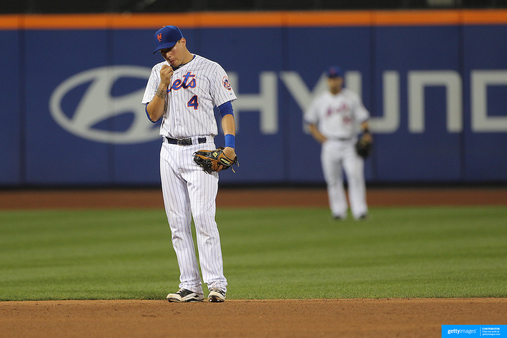 Wilmer Flores, New York Mets, crying while fielding at short stop after learning he had been traded to the Milwaukee Brewers during the game. The trade subsequently fell through. New York Mets Vs San Diego Padres MLB regular season baseball game at Citi Field, Queens, New York. USA. 29th July 2015. Photo Tim Clayton