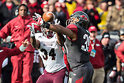 LITTLE ROCK, ARKANSAS - NOVEMBER 23:  Jarrett Lake #39 of the Arkansas Razorbacks knocks down a pass thrown to Josh Robinson #34 of the Mississippi State Bulldogs at War Memorial Stadium on November 23, 2013 in Little Rock, Arkansas.  The Bulldogs defeated the Razorbacks 24-17.  (Photo by Wesley Hitt/Getty Images) *** Local Caption *** Jarrett Lake; Josh Robinson