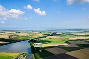 Nederland, Noord-Holland,  Gemeente Wieringermeer, 05-08-2014; overzicht noordelijk deel  Wieringermeerpolder met Waardkanaal en de Pishoek. Amstelmeer en Wieringen aan de horizon.<br /> Overview Wieringermeer polder.<br /> luchtfoto (toeslag op standard tarieven);<br /> aerial photo (additional fee required);<br /> copyright foto/photo Siebe Swart