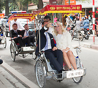 HANOI,  20140319: Crownprince Haakon and crownprincess Mette-Marit  in Hanoi in  Vietnam on a three day official visit. Here watching the streets from a cyclo. .  FOTO: TOM HANSEN