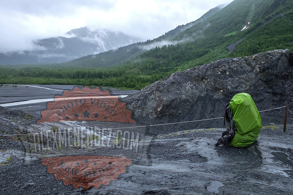 A lone backpack is seen resting as it overlooks the washout plain at Exit Glacier in the Kenai Fjords National Park in Seward, Alaska, on Thursday, August 4, 2016. (Alex Menendez via AP)