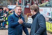 John Robertson, manager of Inverness Caledonian Thistle FC (left) shakes hands with Robbie Neilson, manager of Dundee United FC before the William Hill Scottish Cup quarter final match between Dundee United and Inverness CT at Tannadice Park, Dundee, Scotland on 3 March 2019.