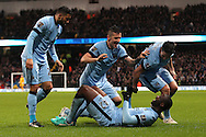 Yaya Toure of Manchester City celebrates with Gael Clichy, Stevan Jovetic and Samir Nasri after scoring the first goal against Sunderland during the Barclays Premier League match at the Etihad Stadium, Manchester.<br /> Picture by Michael Sedgwick/Focus Images Ltd +44 7900 363072<br /> 01/01/2015
