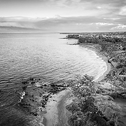 Maui Hawaii aerial drone black and white photo of Keawakapu Beach at sunrise with Maalaea Bay. Keawakapu Beach is a popular spot in Wailea-Makena Kihei Hawaii. Copyright ⓒ 2019 Paul Velgos with All Rights Reserved.