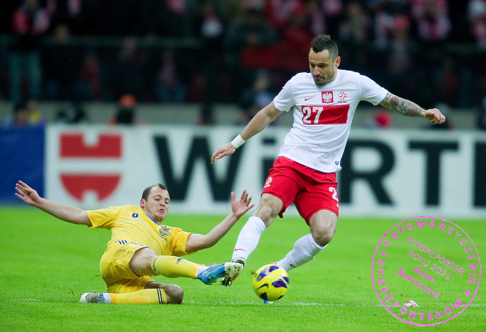 (R) Marcin Wasilewski of Poland fights for the ball with (L) Roma Zozula of Ukraine during the 2014 World Cup Qualifying Group H soccer match between Poland and Ukraine at National Stadium in Warsaw on March 22, 2013...Poland, Warsaw, March 22, 2013...Picture also available in RAW (NEF) or TIFF format on special request...For editorial use only. Any commercial or promotional use requires permission...Photo by © Adam Nurkiewicz / Mediasport