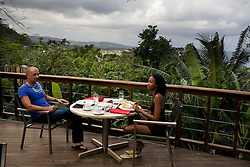 Guests eat breakfast on the terrace of the Bushbar at the Geejam hotel, a luxury boutique hotel with a state of the art recording studio that has attracted famous musicians to make their albums.