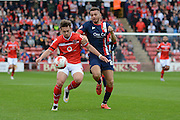 Aaron Taylor-Sinclair challenges Tom Bradshaw during the Sky Bet League 1 match between Walsall and Doncaster Rovers at the Banks's Stadium, Walsall, England on 12 September 2015. Photo by Alan Franklin.