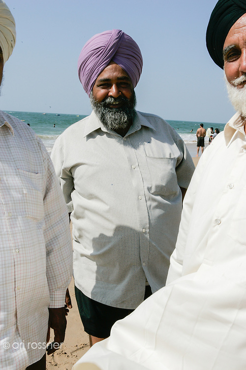 Portrait of Sikh men with turban  at the beach