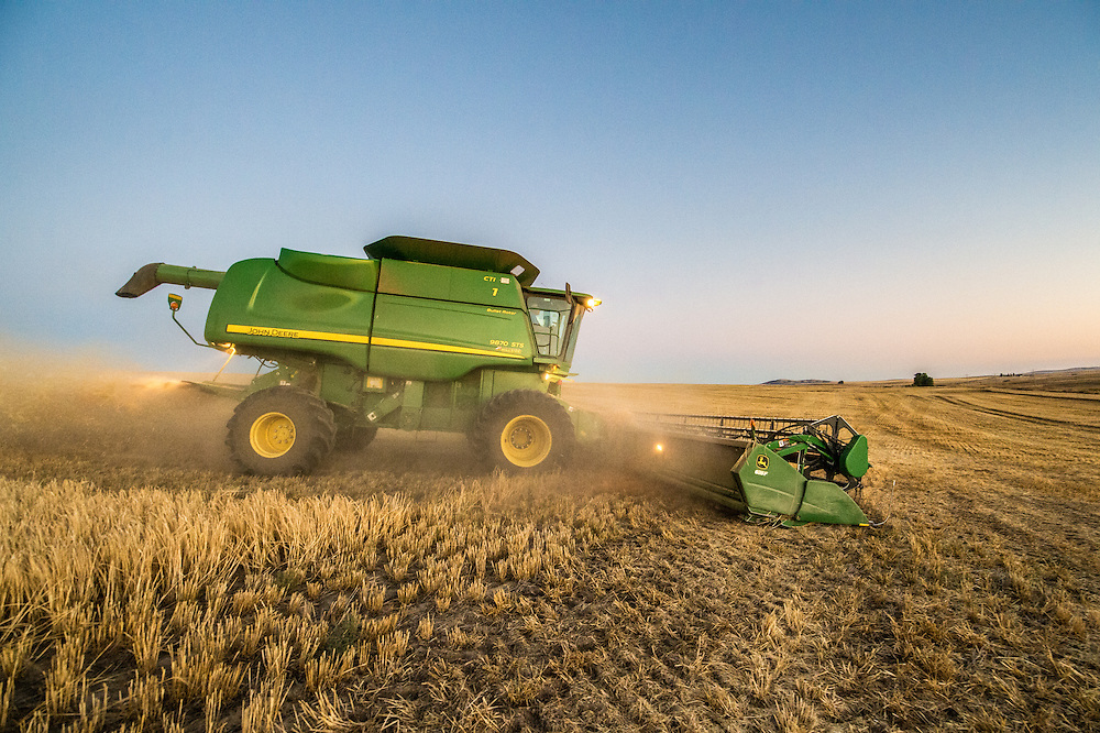 A combine harvester collects and harvests barley grains on a farm in Reardan, Washington.