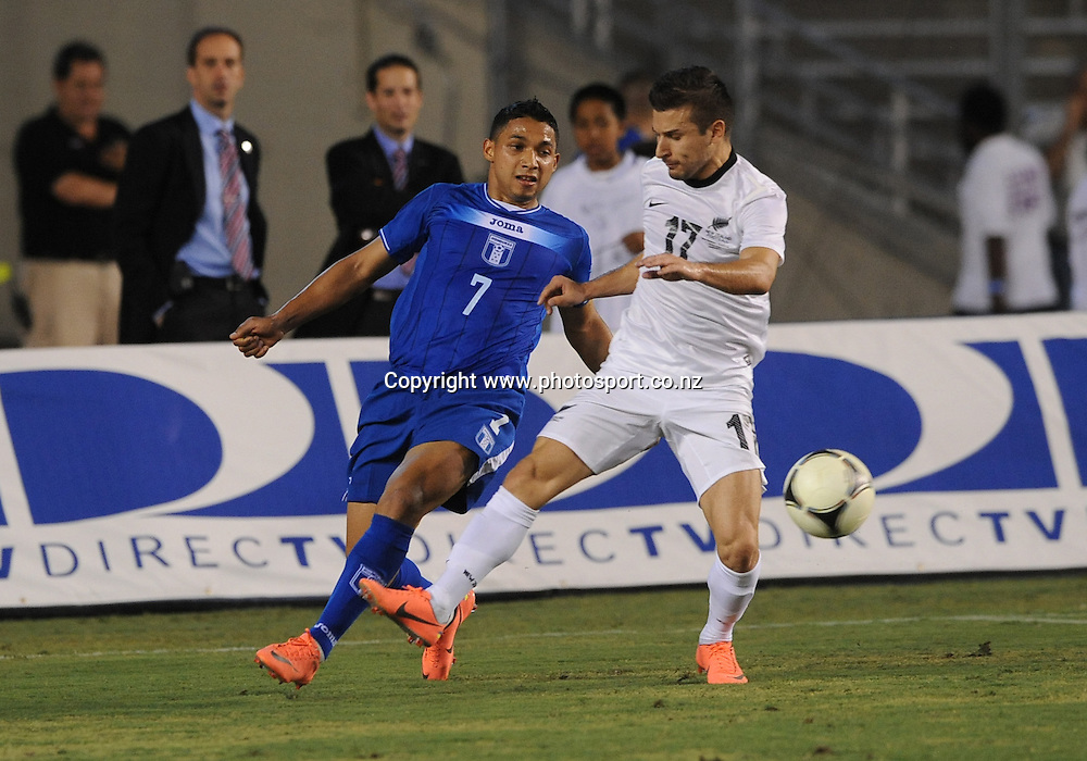 May 26, 2012: Honduras Emilio Izaguirre #7 setting up the play against New Zealand Kosta Barbaroosos #17 during the game between the New Zealand and the Honduras at the Cotton Bowl Stadium in Dallas, Texas. New Zealand wins against Honduras, 1-0.