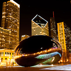 """Chicago Cloud Gate sculpture at night, also known as """"The Bean"""" for its bean shape. Cloud Gate is located in Millennium Park in Grant Park in the downtown Chicago Loop. In February 2012 a light show named Luminous Field was added."""