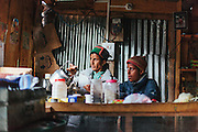Lady standing with her son in their tea shop in Chitkul village of Kinnaur. Famous for being the last village of India.