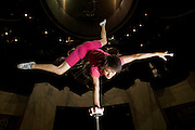 Cao Xiaoli, a professional acrobat, practices balancing on one hand at Shanghai Circus World in Shanghai, China. (Featured in the book What I Eat: Around the World in 80 Diets.)  The caloric value of her day's worth of food on a typical day in June was 1700 kcals.  She is 16 years of age; 5 feet, 2 inches tall; and 99 pounds.  Cao Xiaoli lives in  a room with nine other girls. She started her career as a child, performing with a regional troupe in her home province of Anhui. Now she practices five hours a day, attends school with the other members of her troupe, and performs seven days a week. She says what she likes best about being an acrobat is the crowd's reaction when she does something seemingly dangerous. MODEL RELEASED.