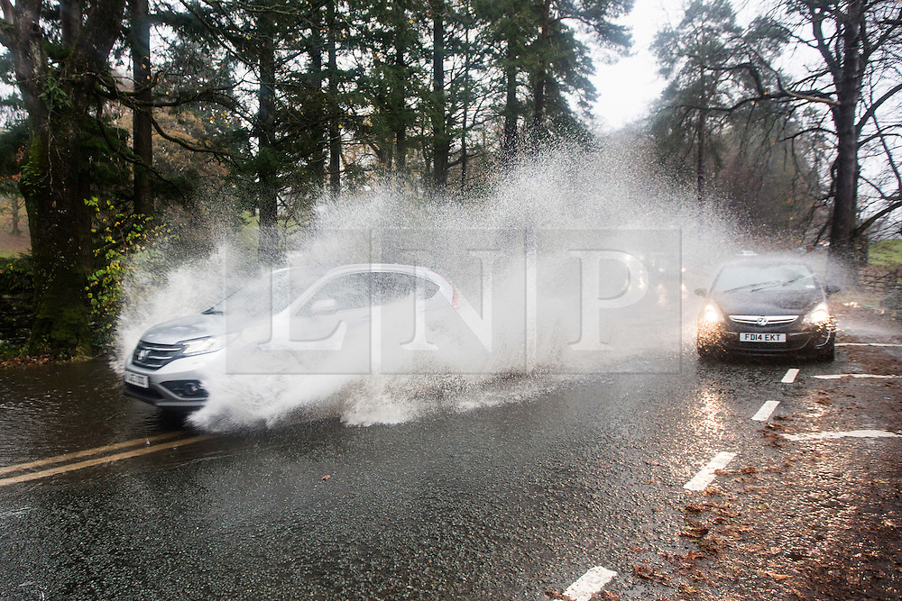 © Licensed to London News Pictures. 15/11/2015. Ambleside UK. Flooded roads are causing traffic chaos around Ambleside after last nights heavy rainfall, more rain is expected & the Environment agency have issued alerts for the area. Photo credit: Andrew McCaren/LNP