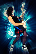 Digitally enhanced image of a Female guitarist playing an electric guitar