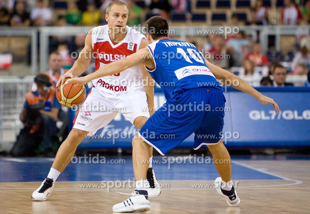 Lukasz Koszarek of Poland vs Uros Tripkovic of Serbia during the EuroBasket 2009 Group F match between Poland and Serbia, on September 12, 2009 in Arena Lodz, Hala Sportowa, Lodz, Poland.  (Photo by Vid Ponikvar / Sportida)